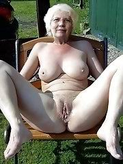 Dressed grandmother shows tits
