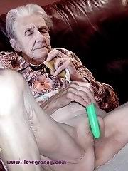 Horny grandma licking her boobs after striptease